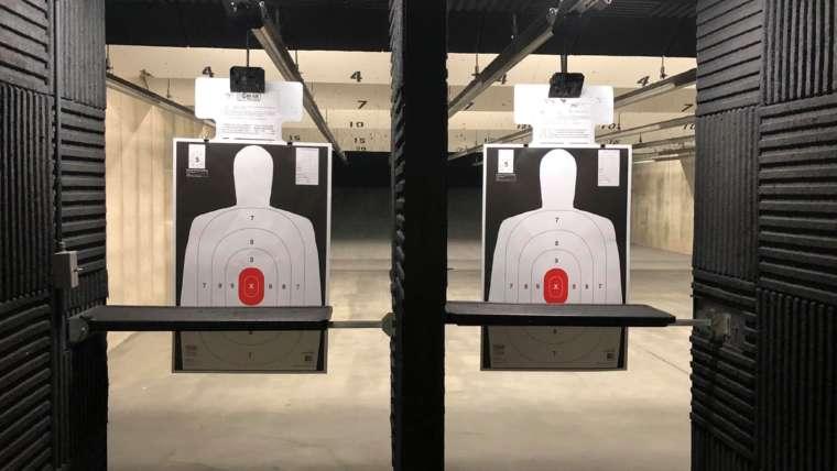 Indoor shooting range lanes with paper targets