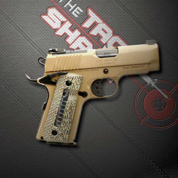 semi automatic pistol on black mat for tac shack firearm webinars